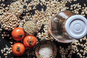 close up healthy diet food raw cereals with tomato and bottle