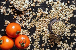 close up healthy diet food raw cereals with tomato
