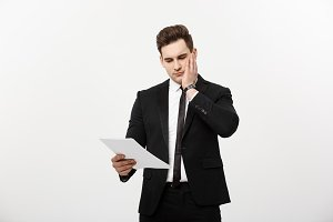 Young hansome businessman with a document in his hands isolated over white background.