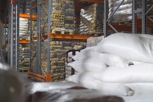 A bags with sugar inside a large industrial warehouse