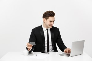 Young businessman with notebook and credit card isolated over white background