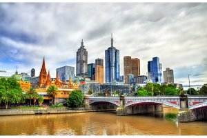 Skyline of Melbourne along the Yarra River and Princes Bridge - Australia