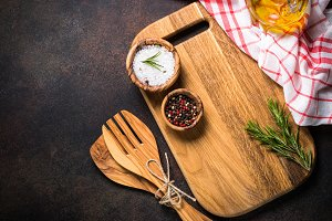 Cooking utensils with spices and herbs top view.