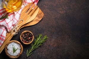 Food background with cooking utensils,  spices and herbs top vie