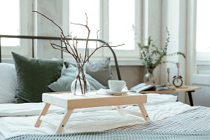Wooden Breakfast table on the bed