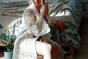 sexy girl in white robe in bedroom