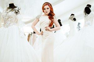bride tries on a wedding dress