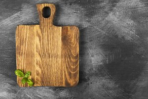 Wooden cutting board, basil
