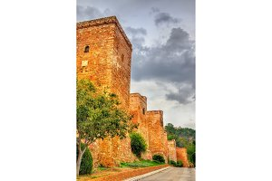Stone walls and towers of the Alcazaba Fortress in Malaga. Spain. Andalusia.