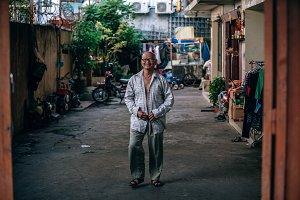 Cambodian Man Putting on His Shirt