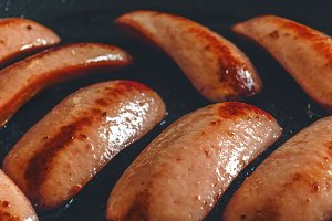 Sausages fried frying pan