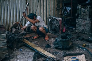 Cambodian Man Working