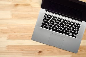 Open laptop computer on wooden desk