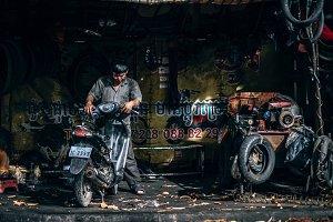 Man Repairing a Motorcycle