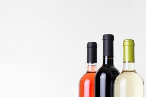 bottles of wine on gray background