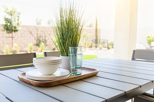 Outdoor Patio Setting with Dishes an