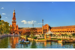 Boat with tourists on a canal at the Plaza de Espana - Seville, Andalusia