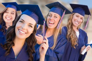 Happy Graduate Girls In Cap & Gown