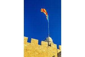 Flag of the Valencian Community on Serranos Gate - Valencia, Spain