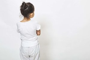 Back view of little girl looking at wall