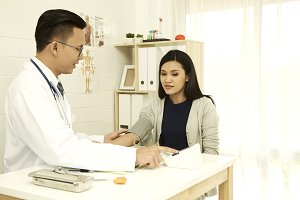 Asian women are giving doctor a checkup