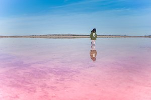 little girl walking on salt lake