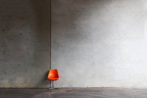 leather chair with concrete wall