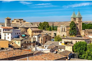 Skyline of Toledo with Santiago del Arrabal Church and Puerta de Bisagra Nueva Gate. Spain
