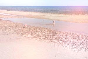 Two kids having fun at beach
