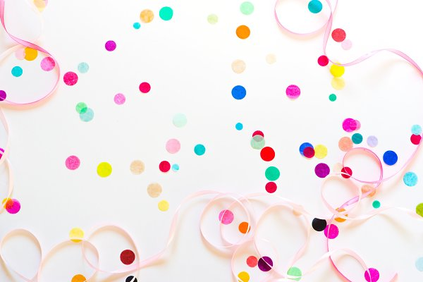 Colorful party confetti with copy s…
