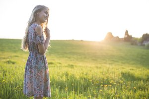 Beautiful girl standing in field