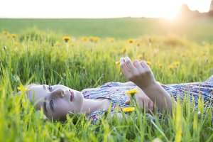 Young girl dreaming in fields