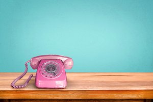 Old retro pink telephone