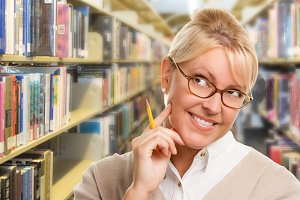 Female in Library with Pencil