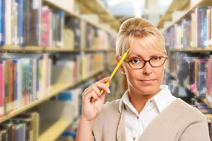 Girl in Library with Pencil