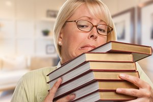 Girl in Office with Stack of Books