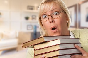 Female in Office with Stack of Books