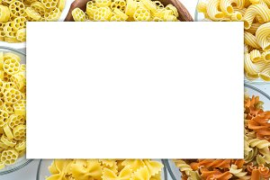 Macaroni ruote Different pasta in a glass and wooden bowl with spirals on a white background, close-up view from top. White space for text and ideas.