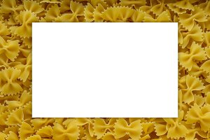 farfalle macaroni background with pasta. A view from the top, a close-up of a texture. White space for text and ideas.