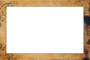 A wooden board with wrinkled colors and a drawing caused. Textured background view from the top. White space for text and ideas.