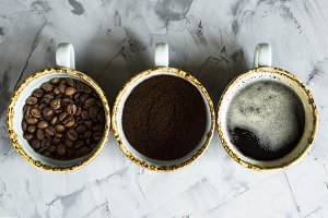 Three cups of various coffee