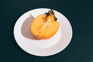 Sliced orange persimmon