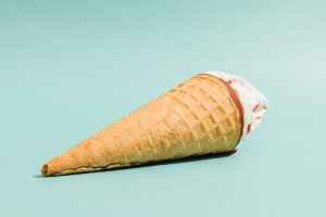 Ice cream cone lay on a blue table