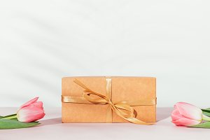 Gift box with beige ribbon and pink