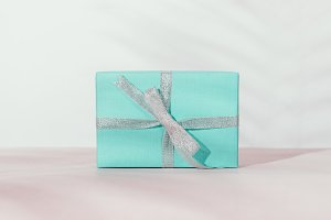 Gift in a blue box with a silver