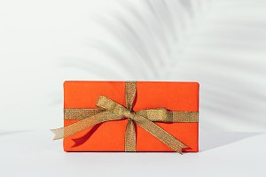 Gift in a red box with golden ribbon