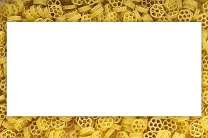 Macaroni ruote background with pasta. A view from the top, a close-up of a texture. White space for text and ideas.