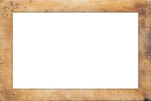 A textured wooden cutting board. Close-up view from top. White space for text and ideas.