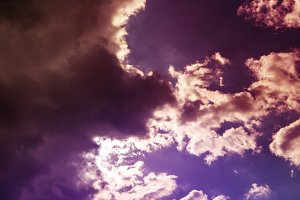 beautiful dreamy fantastic cloudy sky with sun between them background