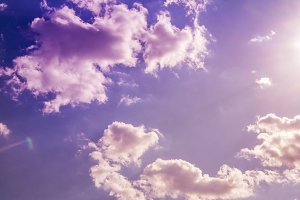 fantastic magical cloudy sky coloured with soft sun and clouds background